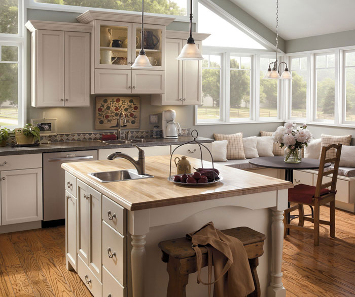 Off white painted kitchen cabinets by Kemper Cabinetry