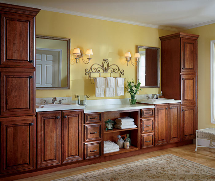 Cherry bathroom cabinets by Kemper Cabinetry