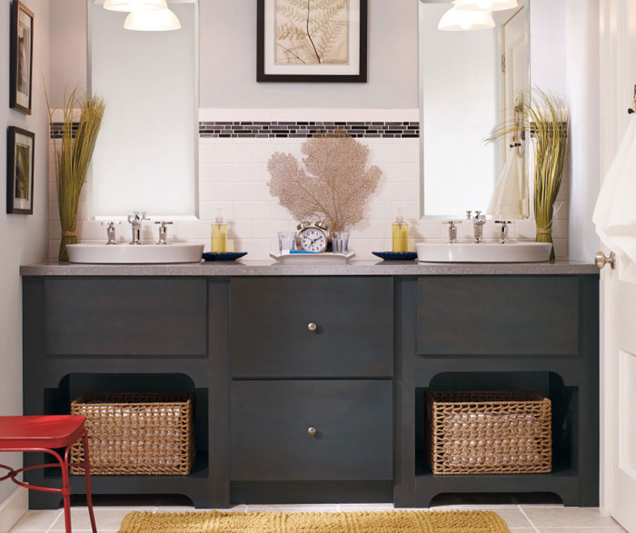 Dark gray bathroom vanity by Kemper Cabinetry
