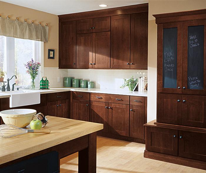 Shaker style kitchen cabinets in a dark Cherry Henna finish